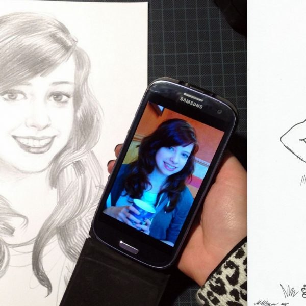 karikaturist aus leipzig mit einer Karikatur vom Handy aus gezeichnet